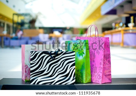 few different shopping bags on the floor