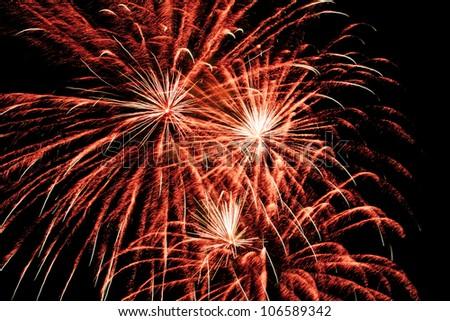 few fireworks blasts on black sky