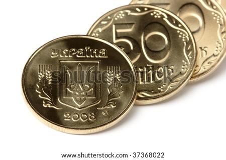 Few golden Ukrainian coins, isolated over white