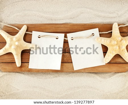 Few marine items on a wooden boards against sandy background. #139277897