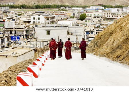few monks walking