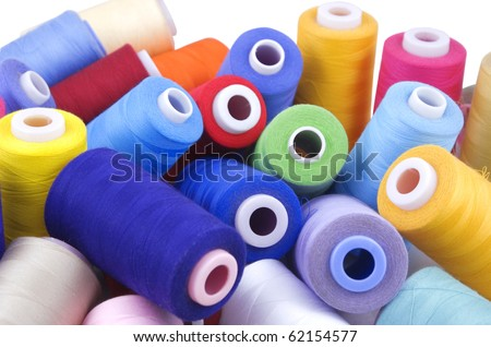 few nice colorful bobbins on white background