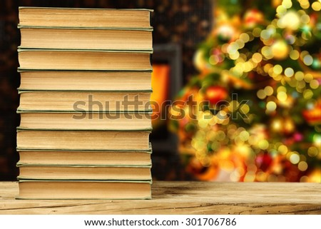few old books christmas books and lights of tree