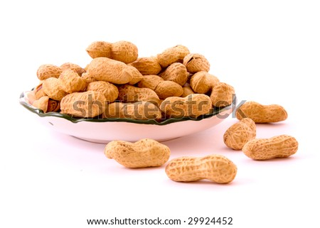 Few peanuts and dish isolated on white