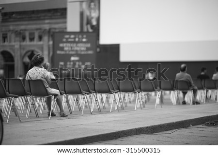 Few people at open-air cinema hall waiting for a movie