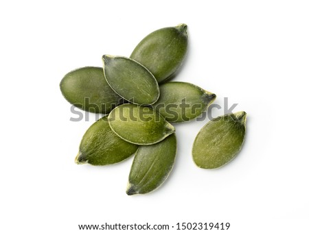 Photo of  few pumpkin seeds isolated on white