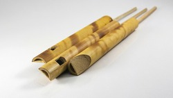 Few small bamboo flutes. popular toy gift of children with sweet sounds. Musical Bird Call Sound Sliding Flute. Flute Imitator Bird Sound. While blowing, pull the small bamboo pole back and forth.