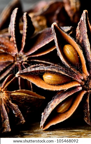 Few star anise on dark wooden table