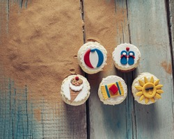 Few Summer Cupcakes On Wooden Planks And Sand