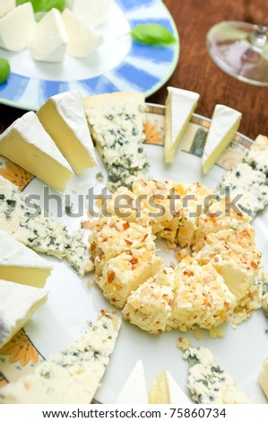 Few types of cheeses on the plates