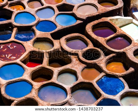 Fez is also famous for its old leather Tanneries. Old tanks of the Fez's tanneries with color paint for leather, Morocco, Africa. Artistic picture. Beauty world
