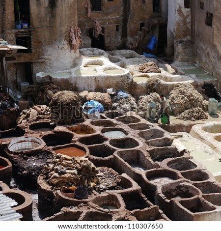 FEZ, MOROCCO - APRIL 1: Worker preparing to treat animal hides that will be dyed in this traditional Moroccan leather tannery on April 1, 2012 in Fez.