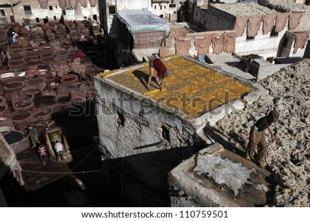 FEZ,MOROCCO-CIRCA NOV.2010:Men work to prepare leather in the famously odiferous tannery inside the walls of the labryrinth North African city, known as Medina in Biblical times circa Nov. 2010 in Fez