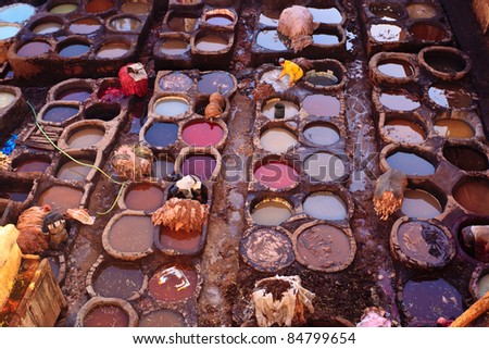FEZ, MOROCCO - DEC 22: Unidentified workers processing hides in colorful tanning pools at a traditional leather tannery,  December 22, 2009 Fez, Morocco.