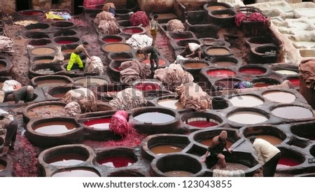 FEZ, MOROCCO - FEBRUARY 19: Unidentified men preparing to treat animal hides that will be dyed in this traditional Moroccan leather tannery on February 19, 2008 in Fez.