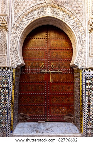 Fez, Morocco: Ornate exterior wooden door of mosque, Fez, Morocco