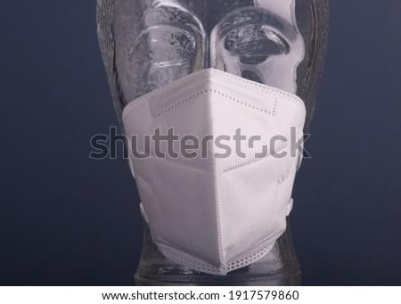 FFP2 protective mask displayed on glass model head. Stok fotoğraf ©
