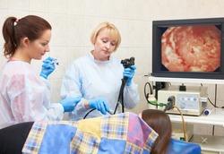fiber endoscopy. Doctor using a fiberoptic scope at gastroscopy