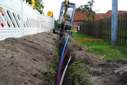 Fiber optic cable laying in the ground, buried cable for faster internet in rural region - 	underground cabling in Rodewald, district of Nienburg, Lower Saxony, Germany