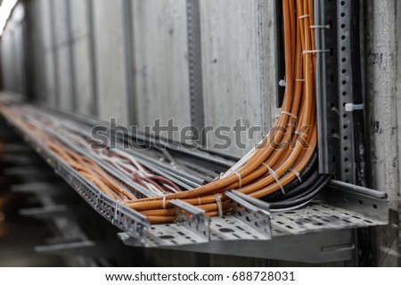 Fiber Optic Network Cables. Fibber channel optical network cables on rails #688728031