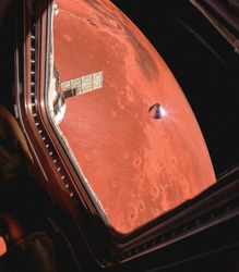Fictional image of planet Mars and an landing module seen through a window of a space station. Concept of a Manned mars mission. Elements of this image are furnished by NASA.