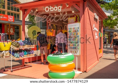 """Fidenza, Italy 08.08.2019 Obag Summer Booth store in """"Fidenza Village Outlet"""" center close to Milan with more than 120 fashion stores in a summar sale period.  #1477874129"""