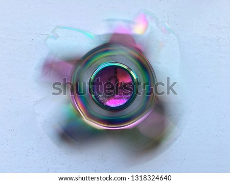 Fidget spinner spinning blurred #1318324640