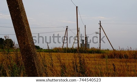 Field and a electric poles #744540523