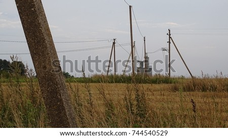 Field and a electric poles #744540529