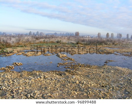 Field and puddle of water landscape