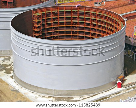 Field construction of a tank with scaffold inside stock photo