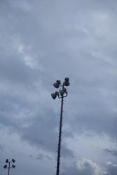 Field lights against a dark, dreary, grey sky