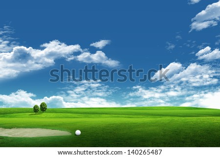 Field of grass, tree, golf and blue sky