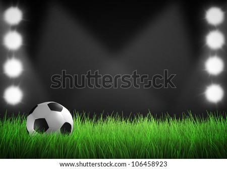 Field of grass with spotlights and football