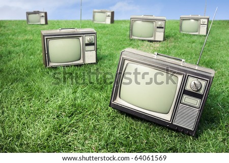 field of grass with tv's