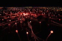 Field of light at night with mostly red lights in NT Australia