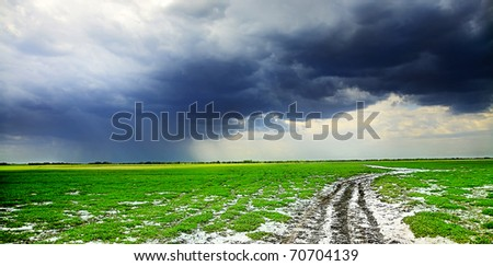 field road and dark clouds