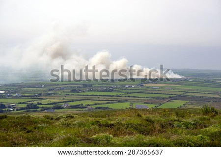 fields on fire in the countryside of kerry ireland