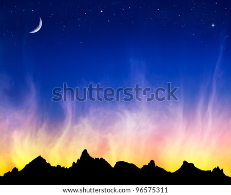 Fiery clouds at sunset with the moon and stars against a mountain silhouette.