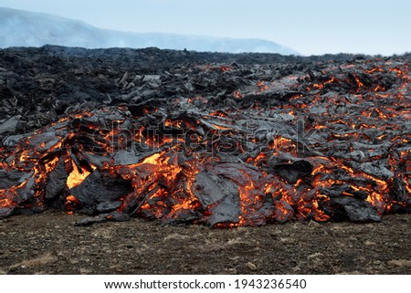 Fiery flowing lava. Volcano eruption at Fagradalsfjall, Iceland. Volcanic background. Photo stock ©