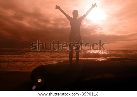 Fiery glory - woman with arms raised on a fiery sunset seascape with dramatic clouds