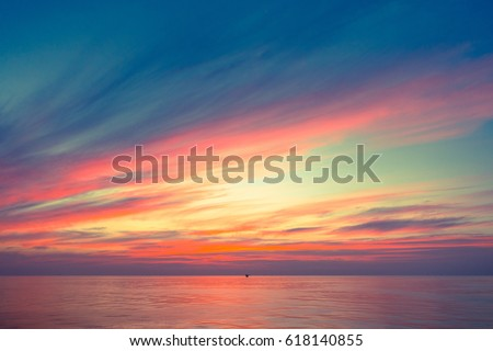 Fiery orange sunset sky warm light with clouds, Beautiful for background with offshor oil and gas platform background #618140855