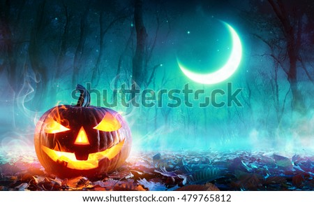 Fiery Pumpkin In A Haunted Forest In The Moonlight  #479765812