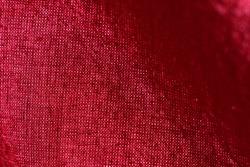 Fiery red fabric with shadow streaks.