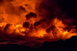 Fiery shots of the active lava flow and volcanos on the Big Island of Hawaii watching the lava flow into the ocean during sunset