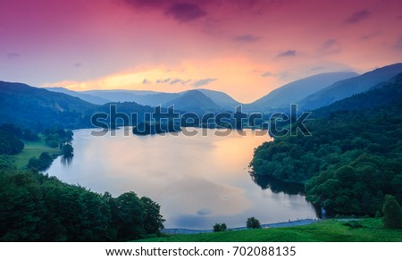 Fiery sky above Grasmere, The Lake District, Cumbria, England #702088135