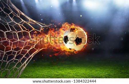 Fiery Soccer Ball In Goal With Net In Flames