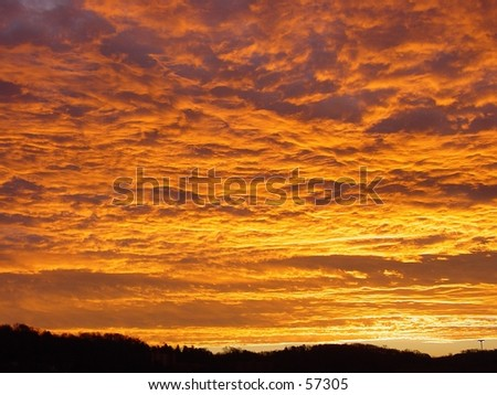 """Fiery sunrise over Charleston West Virginia, known as a """"sailor's warning"""" - stock photo"""
