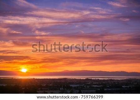 Fiery sunset above San Francisco bay, California #759766399