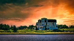 Fiery sunset engulfs a large beach house in Cape May, NJ.